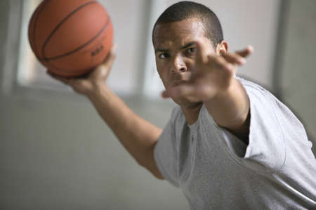 jamaican ethnicity: Man passing a basketball