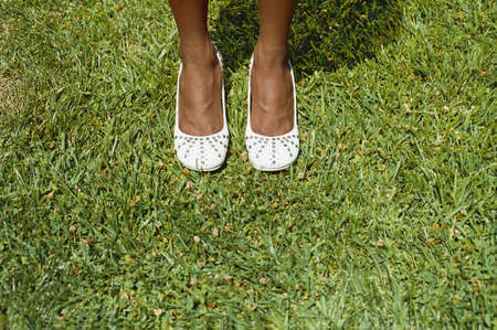 transcendent: Overhead view of woman standing on grass LANG_EVOIMAGES