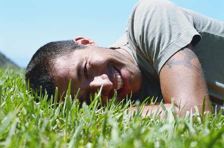 stasis: Man lying on grass