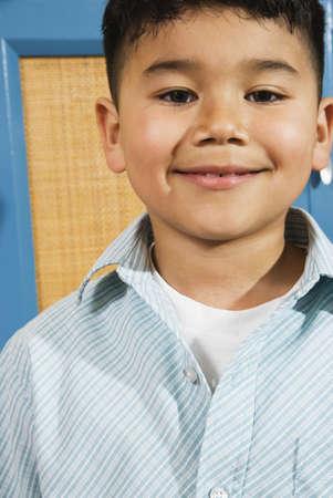 cardboard only: Closeup of boy smiling at camera LANG_EVOIMAGES