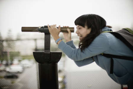 chinese american ethnicity: Woman looking through telescope