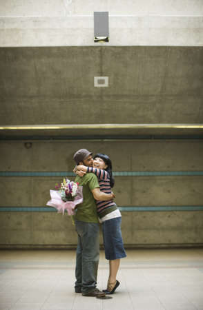 above 21: Young couple hugging