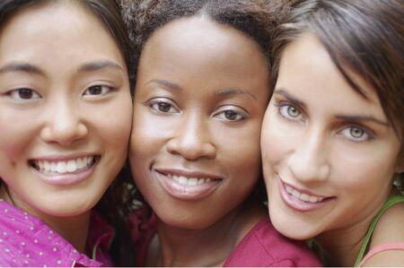 vivacious: Closeup portrait of three female friends