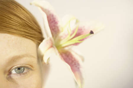 silliness: Woman wearing a flower in her hair