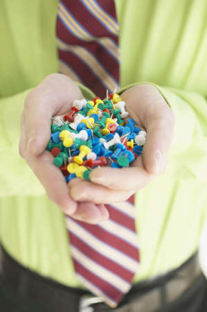 push: Businessman holding push pins