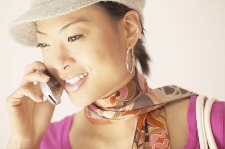 frustrating: Young woman talking on a mobile phone