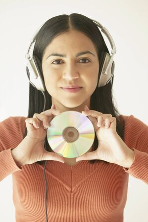 self assured: Woman listening to music with headphones