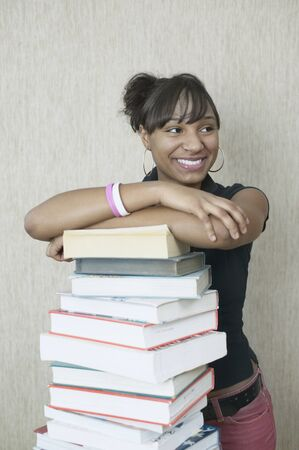 teenaged boys: Teenage girl with stack of books LANG_EVOIMAGES
