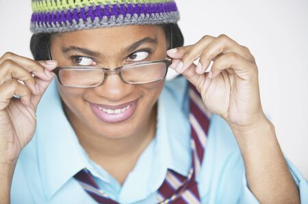 above 30: Woman peering over eyeglasses