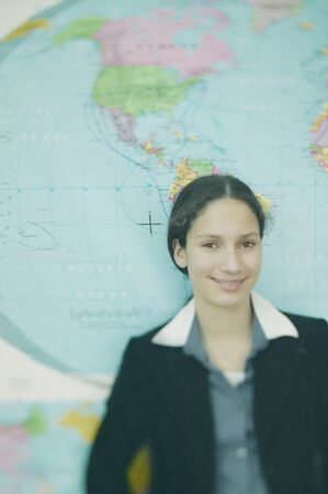 teenaged girls: Teenage girl in front of world map LANG_EVOIMAGES