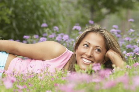 above 18: Young woman lying on the grass