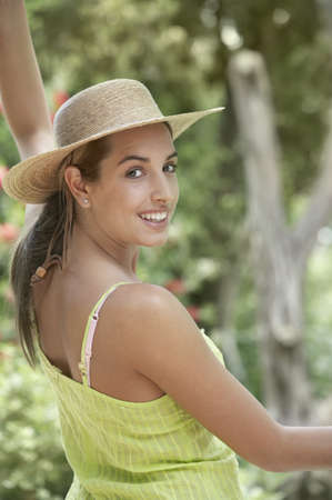 straw the hat: Portrait of woman wearing straw hat