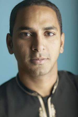 pakistani ethnicity: Portrait of a young man smirking LANG_EVOIMAGES