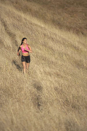 personable: Female runner in grass field