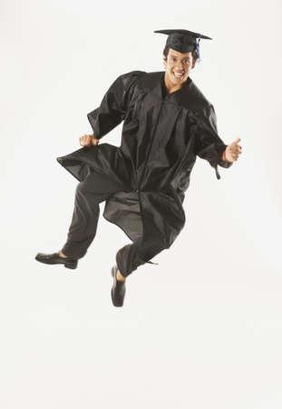 exuberant: Portrait of exuberant male graduate
