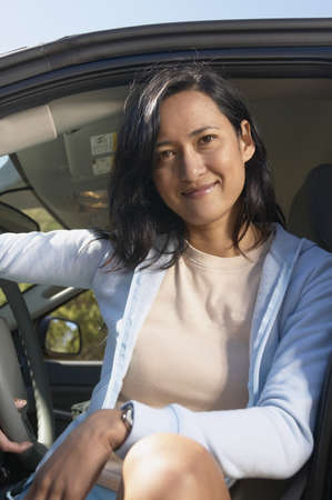 Woman posing in driver seat of SUV Stock Photo