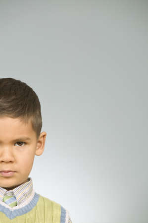 larger than life: Portrait of young boy sulking