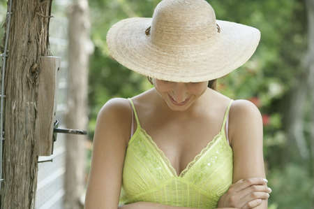 straw the hat: Woman wearing straw hat