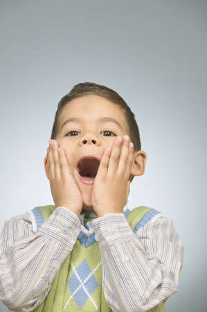 unruly: Young boy with surprised expression