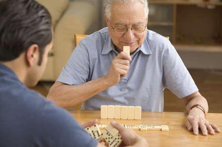 above 21: Senior man playing dominoes LANG_EVOIMAGES