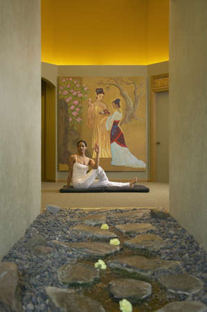 french ethnicity: Young woman exercising in a health spa