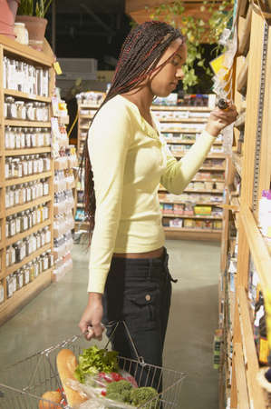 jamaican ethnicity: Teenage girl shopping in a supermarket LANG_EVOIMAGES