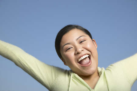 above 21: Portrait of a young woman cheering LANG_EVOIMAGES