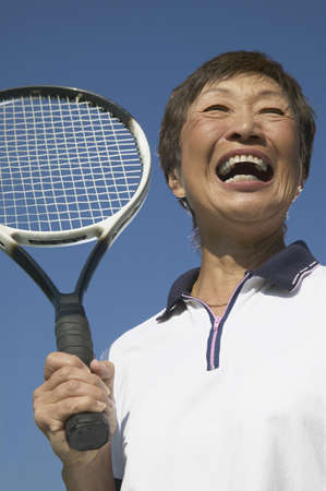 above 30: Low angle view of a senior woman smiling LANG_EVOIMAGES