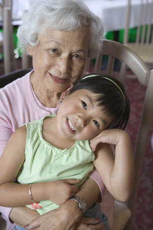 above 30: Portrait of a grandmother and granddaughter