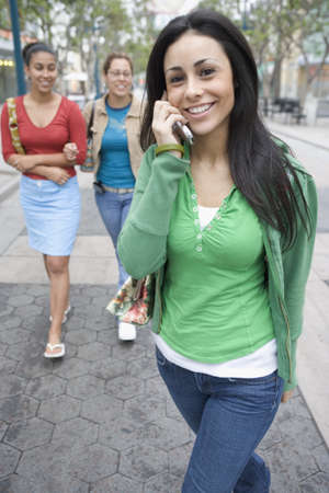 above 18: Girlfriends hanging out with mobile phone