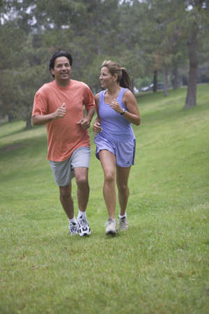 mixed age range: Couple running in the park