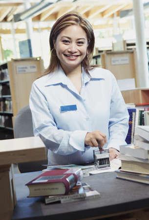 above 30: Librarian using stamper LANG_EVOIMAGES
