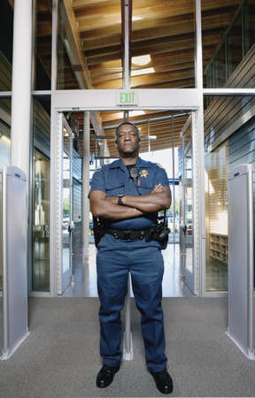 entranceway: Security officer standing by entranceway