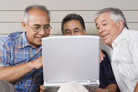 above 30: Three elderly men with laptop