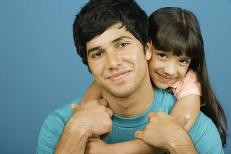 some under 18: Girl hugging young man around his neck
