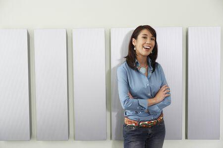 strategizing: Young woman smiling at camera