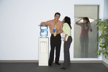 Businesswoman spying on coworkers
