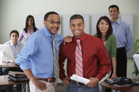 chinese american ethnicity: Group of office coworkers smiling at camera