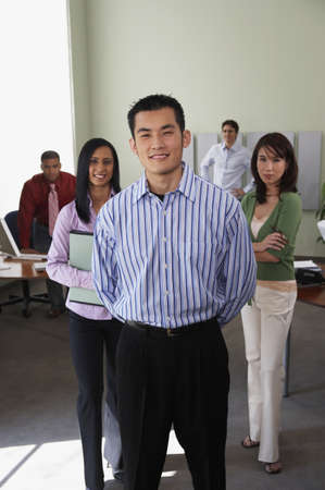 chinese american ethnicity: Businessman with coworkers in background