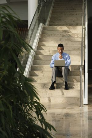 go inside: Business with laptop sitting on steps