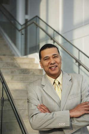 wireless hot spot: Portrait of a smiling businessman LANG_EVOIMAGES