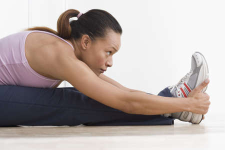 above 30: Side view of woman stretching