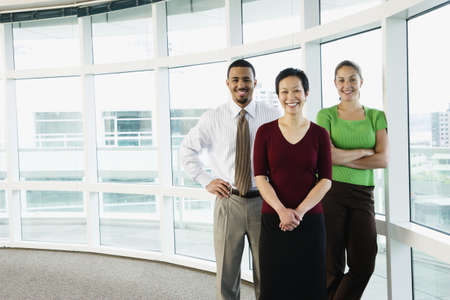 above 30: Portrait of group standing by windows