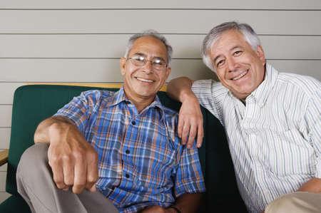 the elderly residence: Portrait of two elderly men sitting and smiling