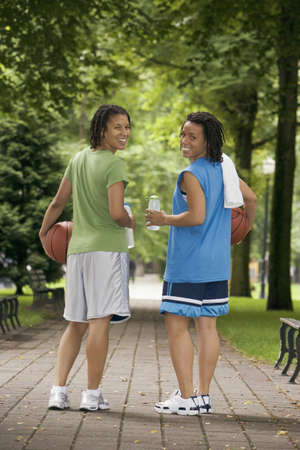 basketballs: Rear view portrait of two teenage girls with basketballs