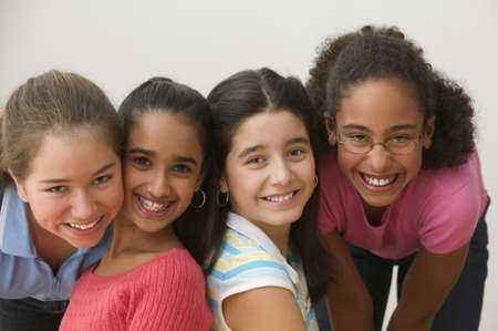 all under 18: Portrait of four girls smiling
