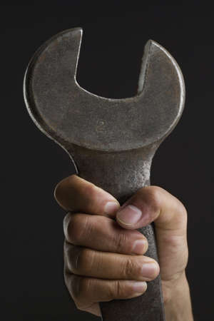 above 30: Close up of hand holding wrench