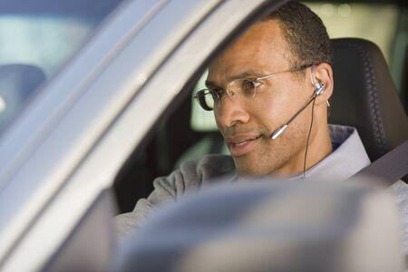 earpiece: Man with earpiece in car