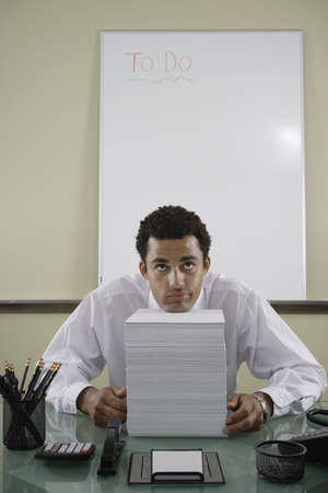 irish ethnicity: Office worker with stack of papers