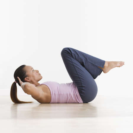 crunches: Side view of woman doing crunches